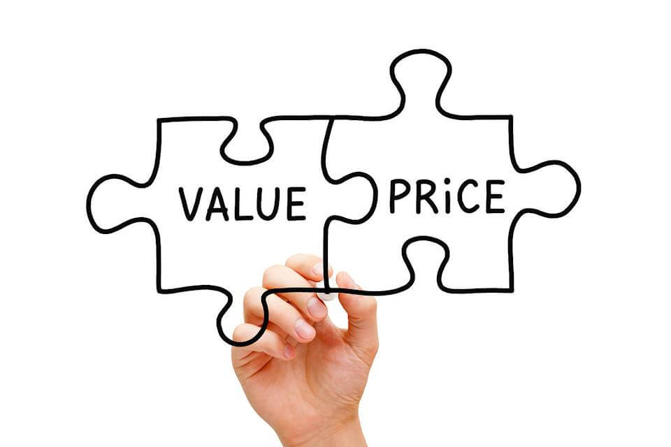 Pieces of a puzzle drawn with one piece that says value and the other that says price connected. High medical costs can be conquered through connecting these two concepts.
