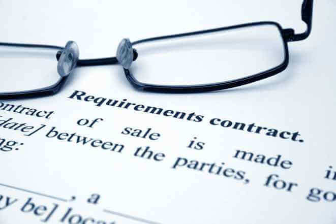 Contract with a pair of eye glasses on it, close up. Crony trade treaties are bad for your health!